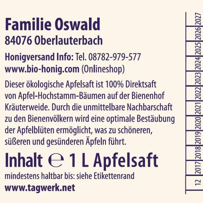 Ausschnitt eines Etikettes vom Tagwerk Apfelsaft von Familie Oswald. Dort ist zu Lesen: Familie Oswald, 84076 Oberlauterbach; Honigversand Info: Tel: 08782-979-577; www.bio-honig.com (Onlineshop); Dieser ökologische Apfelsaft ist 100% Direktsaft von Apfel-Hochstamm-Bäumen auf der Bienenhof Kräuterweide. Durch die unmittelbare Nachbarschaft zu den Bienenvölkern wird eine optimale Bestäubung der Apfelblüten ermöglicht, was zu schöneren, süßeren und gesünderen Äpfeln führt. Inhalt 1 Liter Apfelsaft; www.tagwerk.net